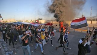 رفع حظر التجول في بغداد وارتفاع عدد قتلى الاضطرابات إلى 72